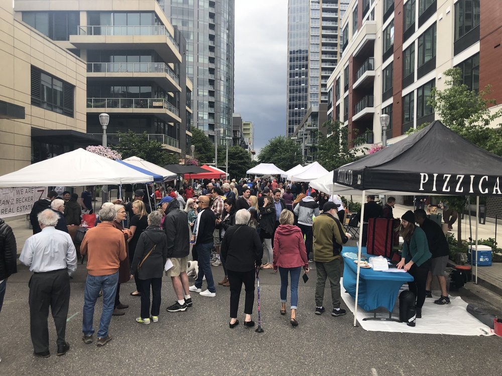 Attendees enjoying the first annual South Waterfront Street Fair in 2018.