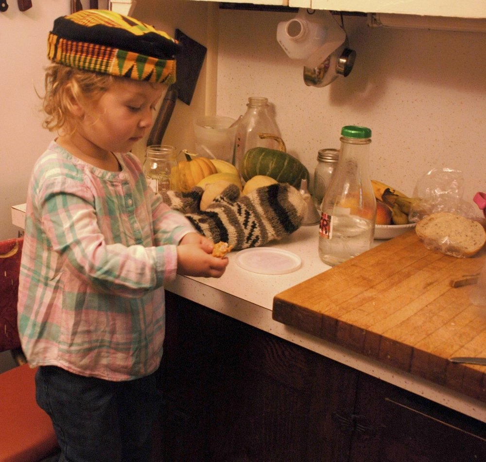 Miriam loves to eat rye bread and peanut butter. Sarah Winter Photo.jpg