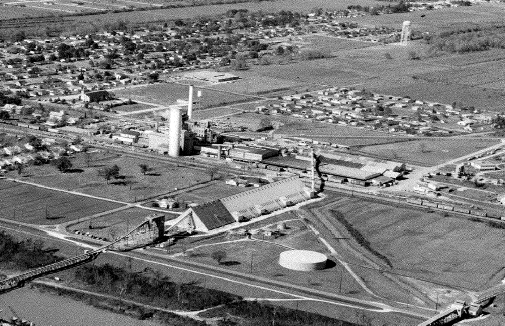 An aerial view of Colonial Sugars and the future site of LSR around 1960.