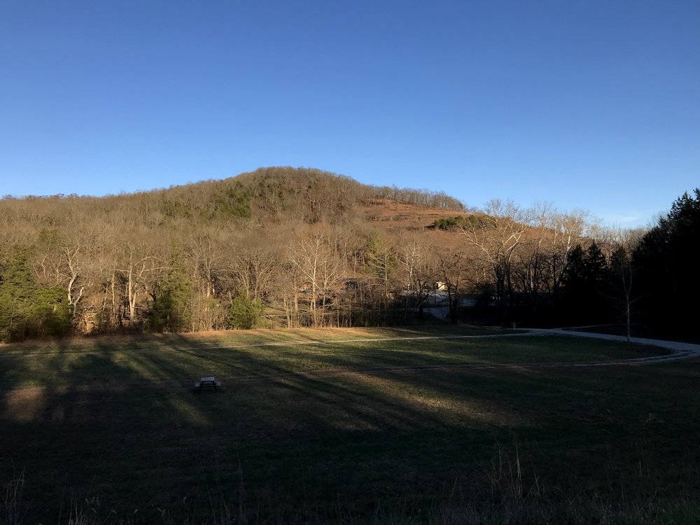 "Part of the campground, Caney Creek, and the ""Visitor Center"" in front of Caney Mountain."