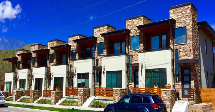 The exterior elevation is gorgeous, boasting a mix of cedar, stucco and rock finishes. Eighth Street Residences in Golden, Colorado