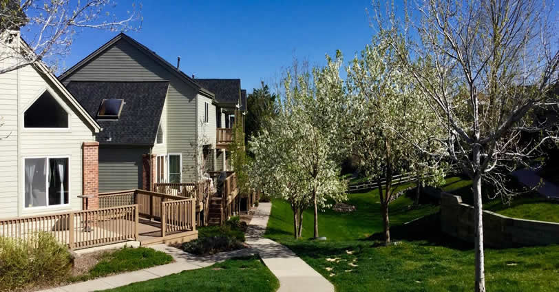 Lush grass walkways meander throughout the grounds at Heritage Village Townhomes in Golden, Colorado
