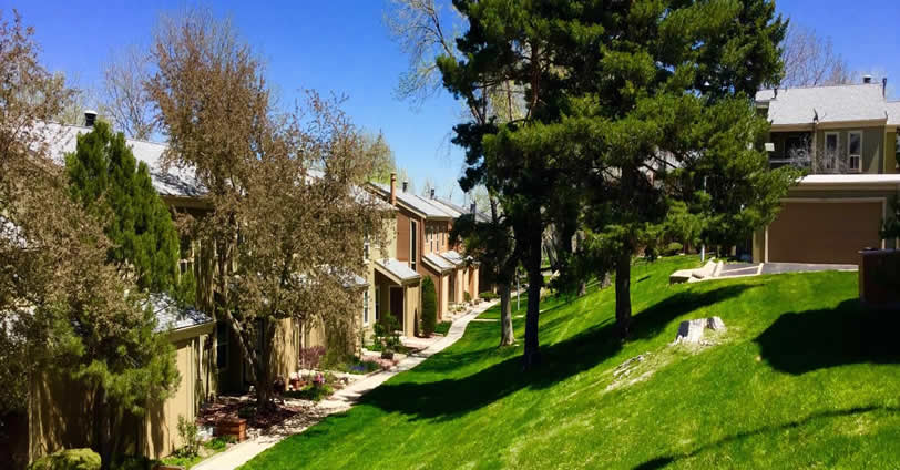 Mountair Village Townhomes courtyards and walkways meander throughout the community's lush grass lawns in Golden, Colorado