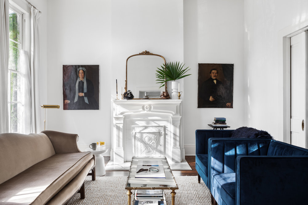 These velvet sofa and chairs really add warmth to the crisp white walls and high ceilings. The sofa is from an estate sale and the chairs are from Target.