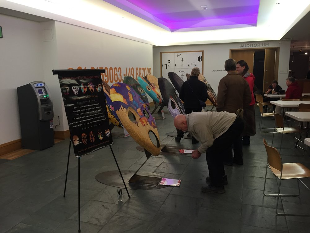 Patrons at the museum on October 1st, 2016 signing masks before the transformation ceremony.