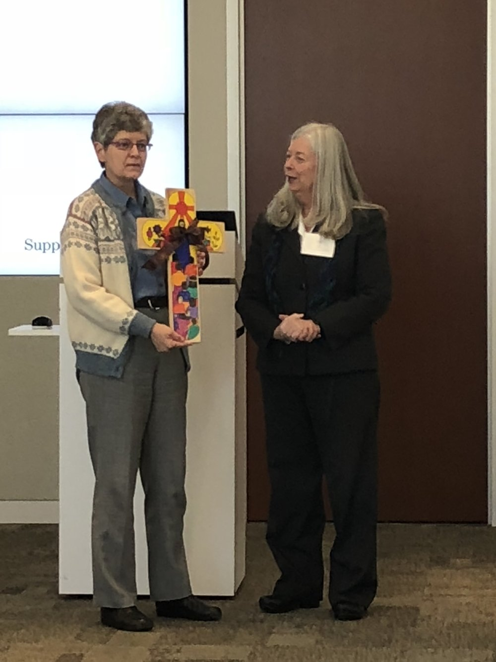 Lois Lane presenting Patty Peters with gift for past chair.JPG