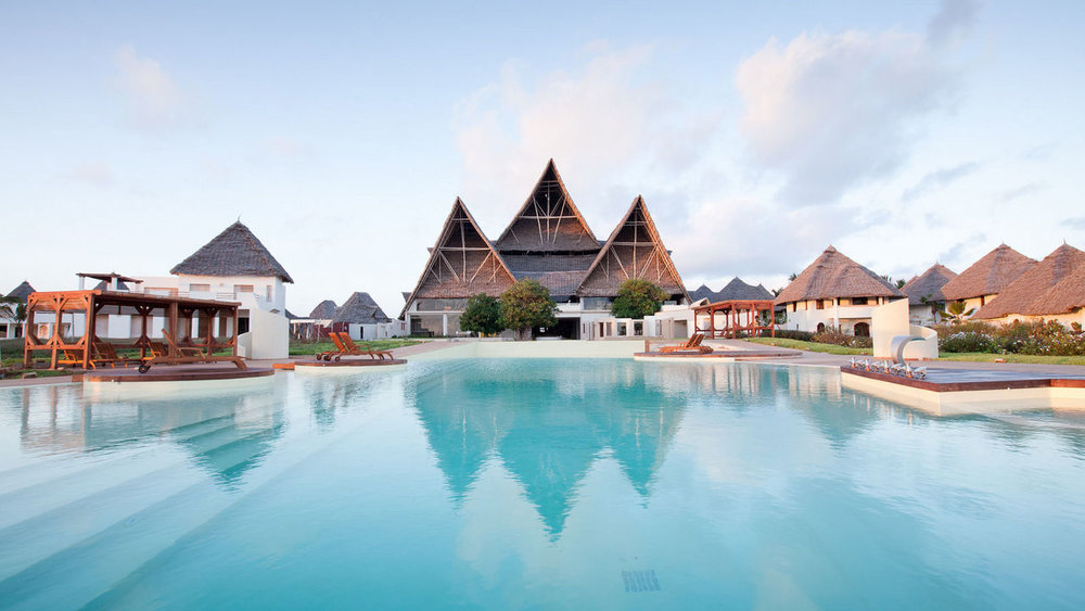 Essque Zalu Zanzibar   Essque Zalu Zanzibar bucks the trend of competing resorts who aim to blend in with their local environment. Instead, big and bold form a consistent theme, from the highest makuti thatched roof on the island, to the two roomy restaurants, three well stocked bars, and sprawling lagoon-style pool.