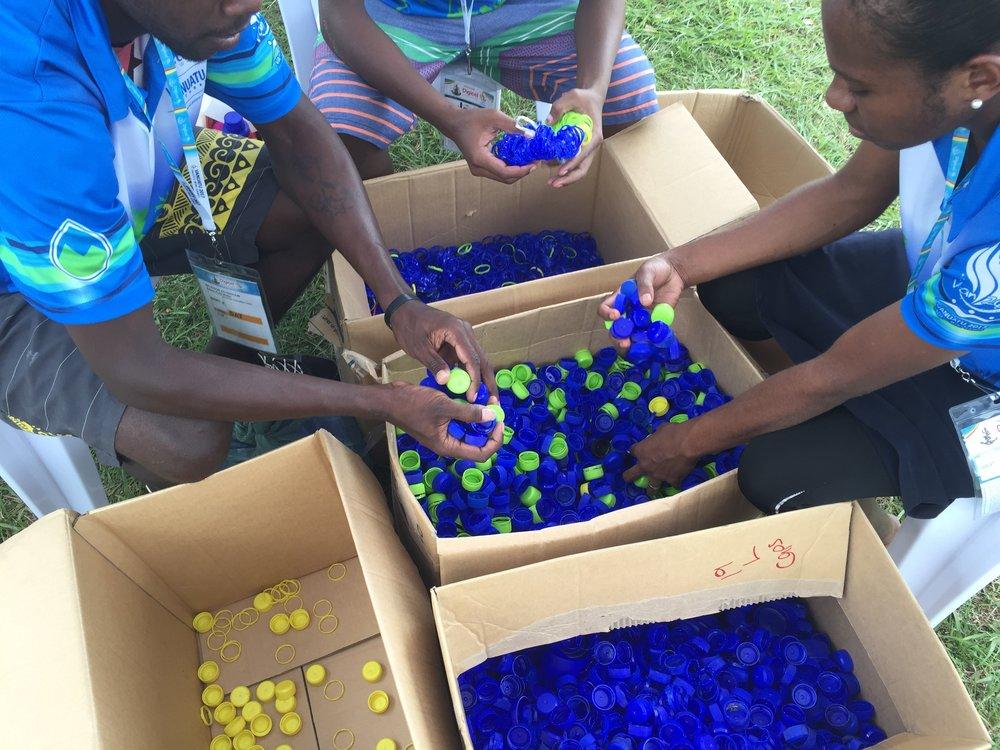 Vanuatu sorting bottle caps.JPG