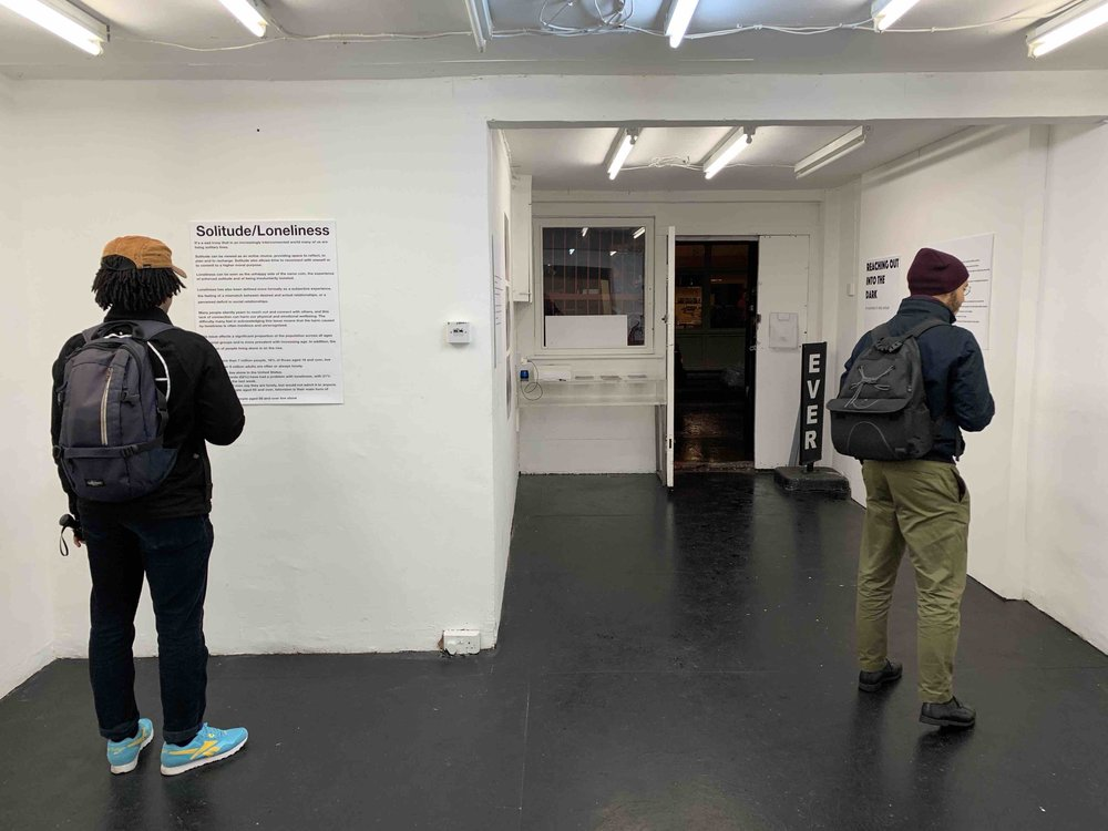 Exhibition visitor reading text