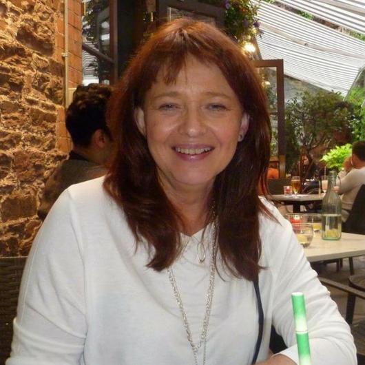Geraldine N. smiling at camera