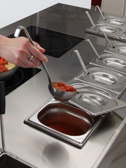 Bain-marie for hot sauces  with 15 trays, plus 4  refrigerated trays for cold sauces.