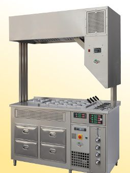 Optional  self-condensing hood  in AISI 304 stainless steel. Through 3 zones of filtration (mechanical, washing, droplet separator) the fumes and steam are captured, condensed and conveyed into water drain. The hood is wired to the station and doesn't need any external electrical or hydraulic connections.