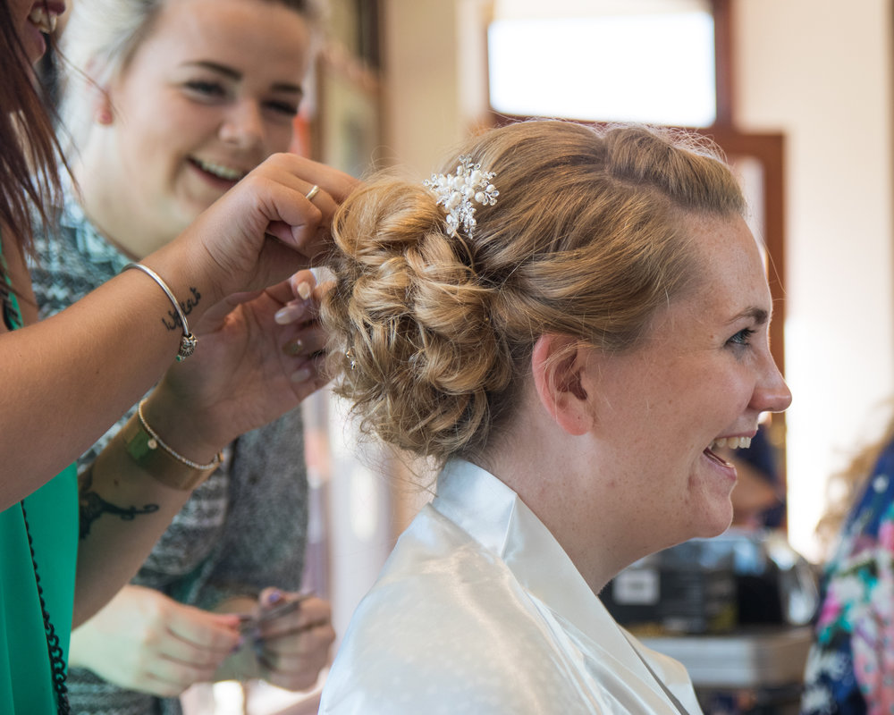 Preparing the brides hair for her wedding in Luton Bedfordshire