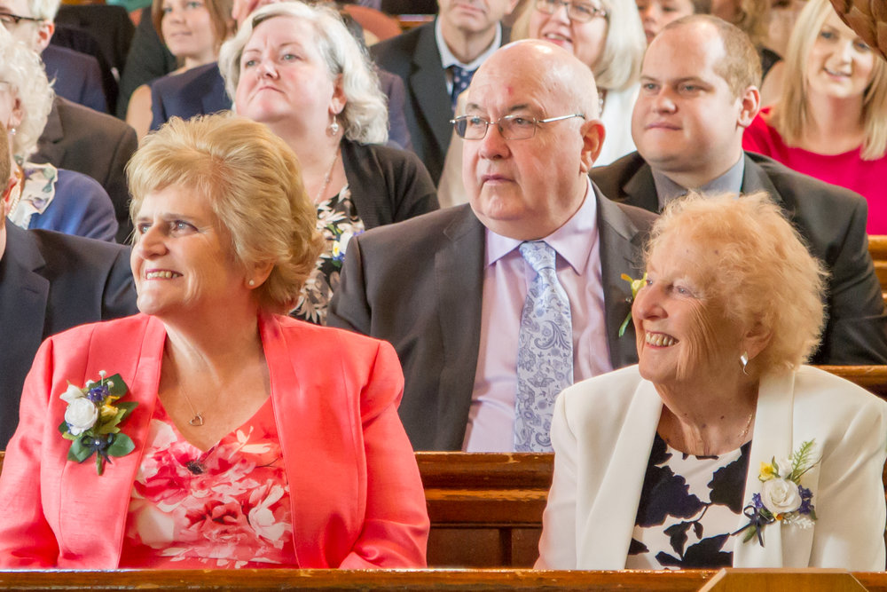 Brides family in the congregation at a wedding in St Thomas's Church  Luton Bedfordshire