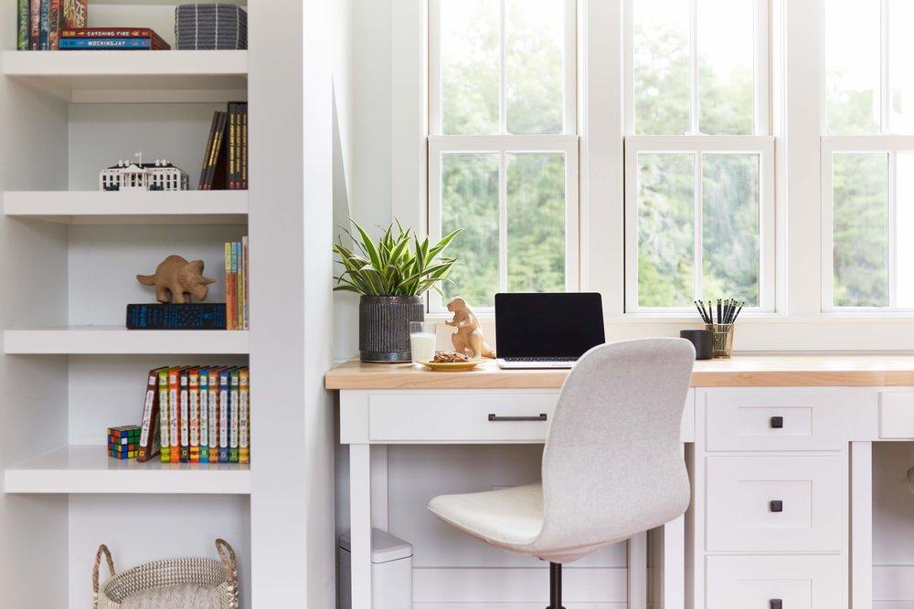 Custom modular desk and built-in shelving detail in kids' study.