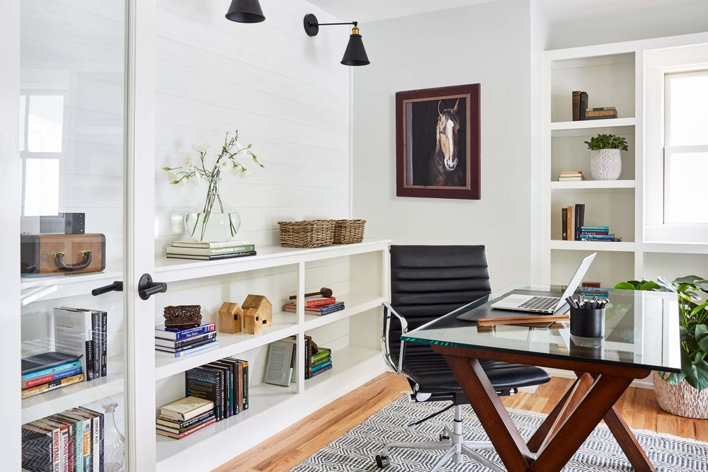 Built-in shelving and shiplap accent wall transformed the former dining room into a study.