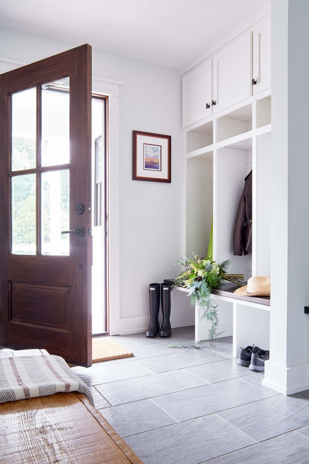 Secondary entry and mudroom with custom cubbies and warm wood accents.