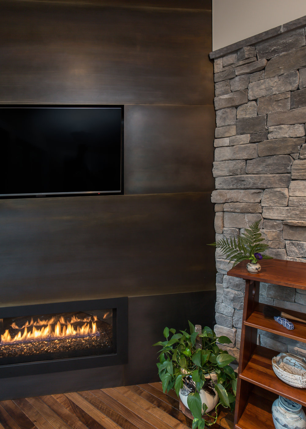 Steel fireplace wall detail.