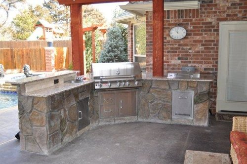 retaining walls  outdoor living areas  patios  pergolas  pavilions  stamped concrete  driveways  outdoor fireplaces  outdoor kitchens  landscaping  swimming pools  Oklahoma  OKC  hardscapes