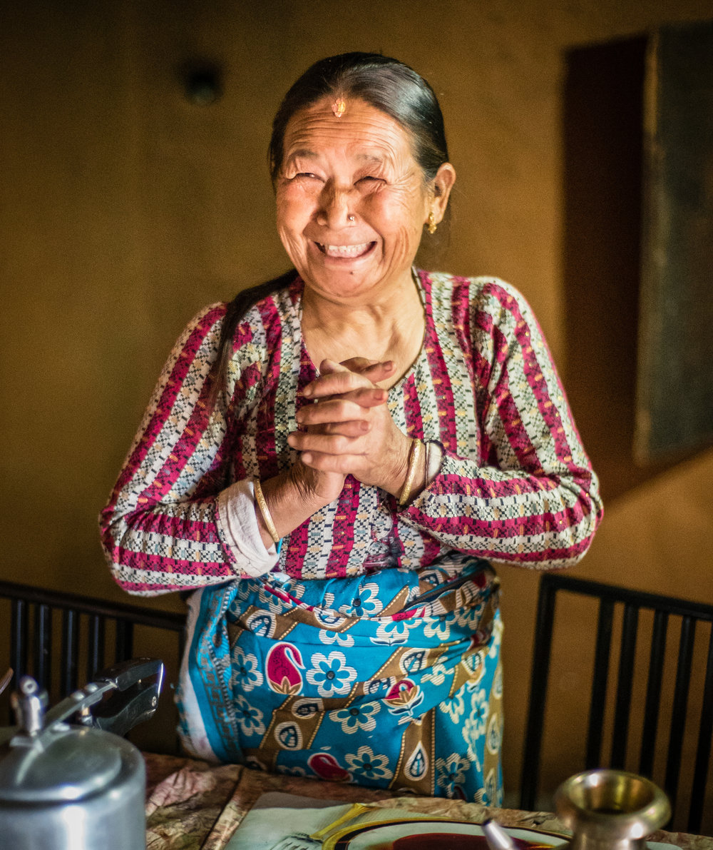 Bhagwati Thapa typifies the spirit of many LF patients who opened their homes and shared their stories to help us document lymphatic filariasis. In the photo Bhagwati is inviting us to stay for tea - which we gladly accepted. Bungmati, Nepal. Photograph: Ecce Opus / © Copyright GSK