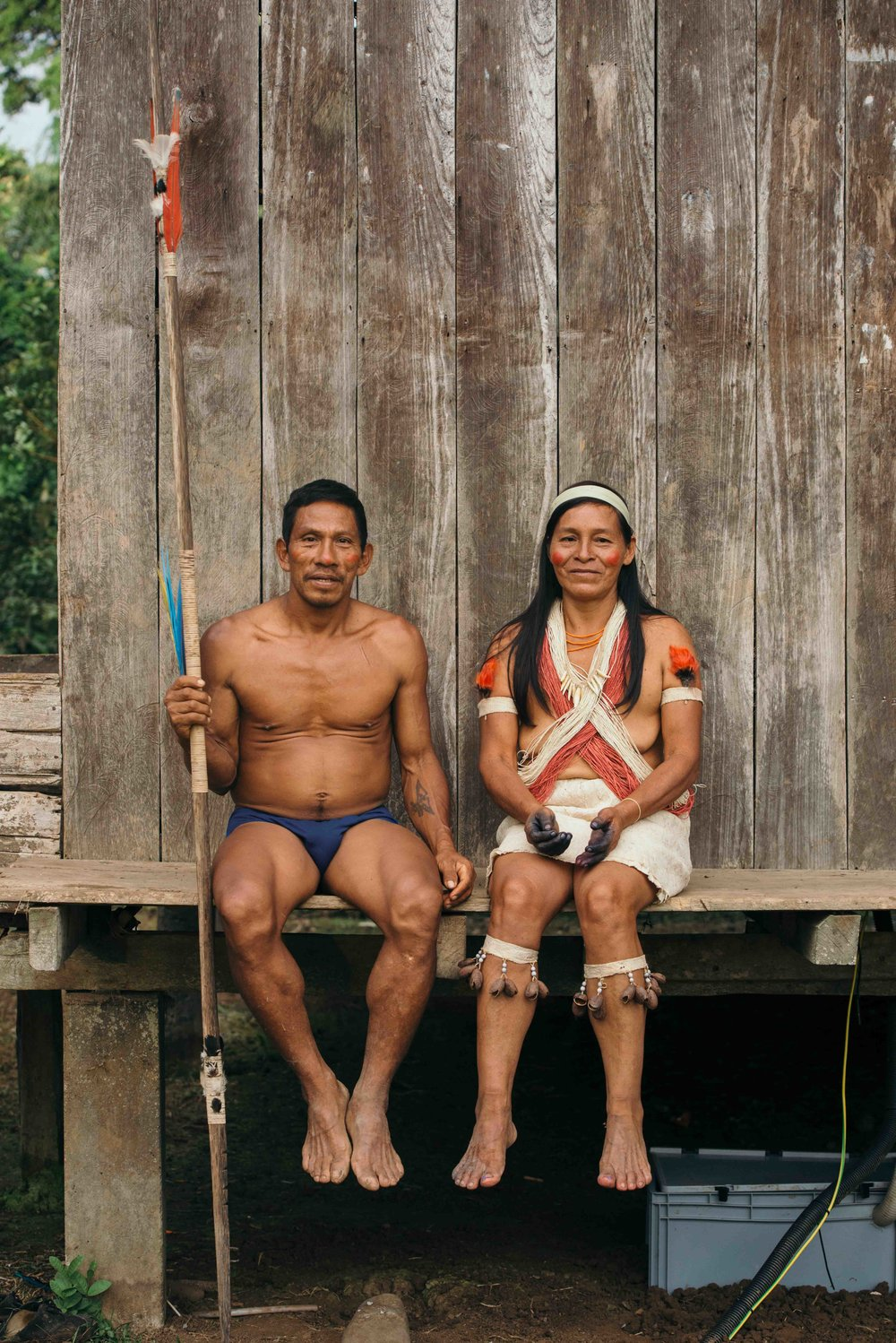 Memo and his wife from the Waorani community Acaro. Underneath their house is the battery protection box from the solar home system.