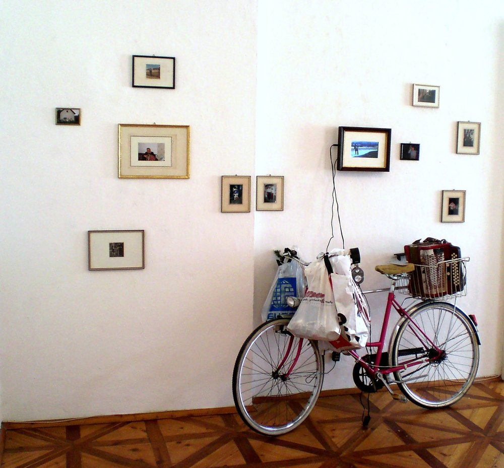 Familiensilber, Galerie3, photos of my grandaddy and his bicycle 100%, 8mm film, myself as grandaddy playing the quetschn, 2012 .jpg