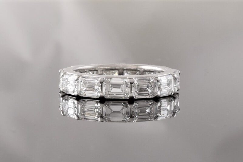 Custom platinum 4.06 carat emerald cut diamond band