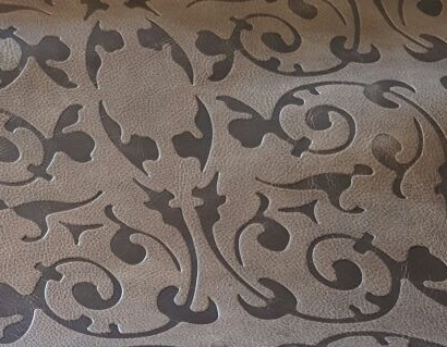 special embossed leather    Available in many designs and finishes , its possible to apply to all categories of leather .