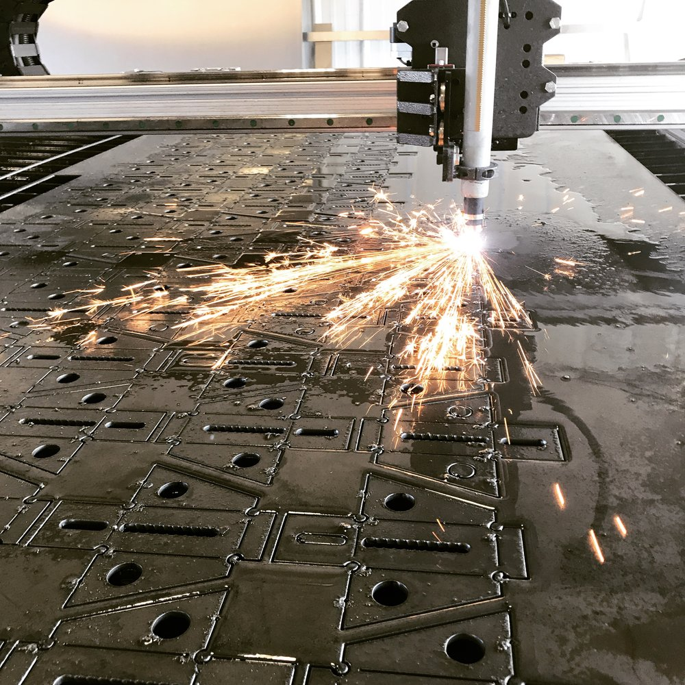 A sheet of Tacoma mounting brackets getting cut. Seems like we can never make enough of these. Tacomas must be popular or something.