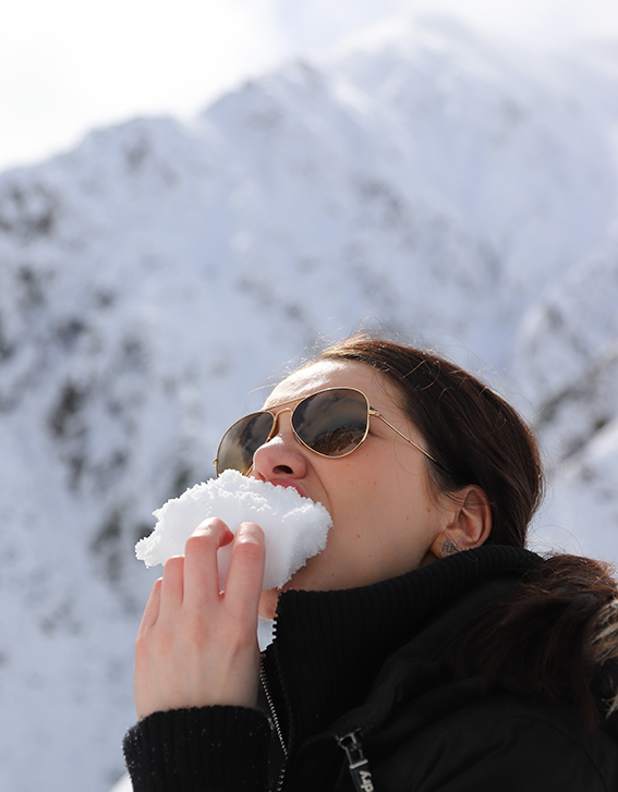 Devouring chunks of pristine snow for refreshment. -