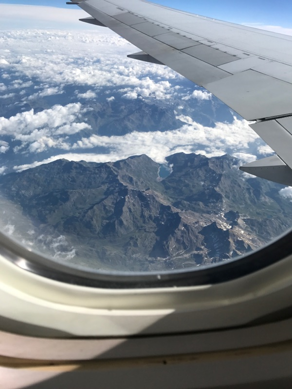 A view of the Alps, complete with picturesque valleys and lakes.
