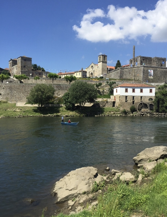 Riverside view of Barcelos on a sunny day: perfect for fishing!