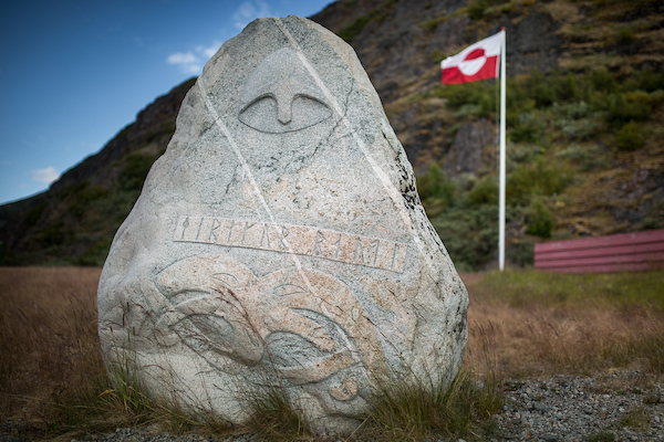 Norse runes on new stone with Greenlandic flag in the background.jpg
