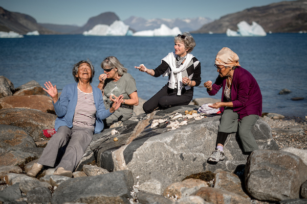 Four women sharing fun stories at an outdoor meal in Narsaq in South Greenland.jpg