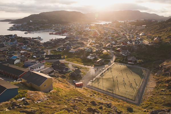 Sunset over a game of soccer and Qaqortoq in South Greenland.jpg