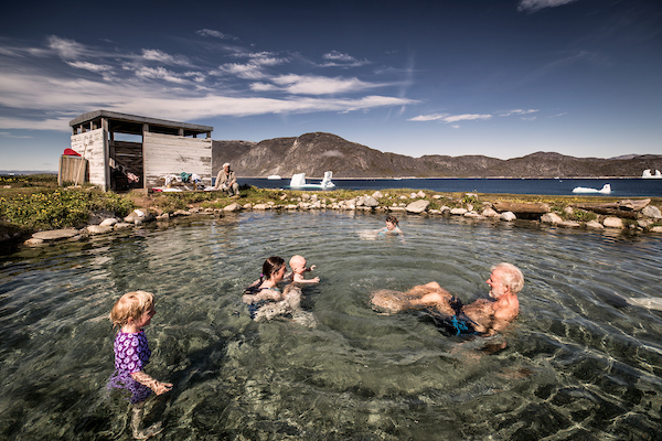 A family enjoying the Uunartoq hot springs in South Greenland.jpg