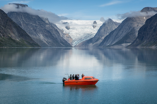 A small passenger boat near the bottom of the Tasermiut fjord in South Greenland.jpg