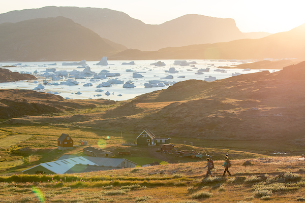 Two hikers approaching Tasiusaq sheep farm in South Greenland.jpg