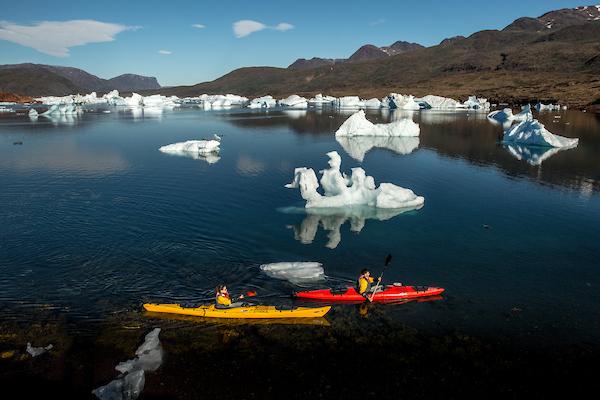 Two kayakers in the fjord Sermilik near Tasiusaq sheep farm in South Greenland.jpg