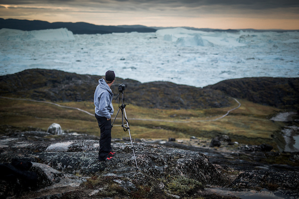 A photographer near the Ilulissat ice fjord in Greenland.jpg