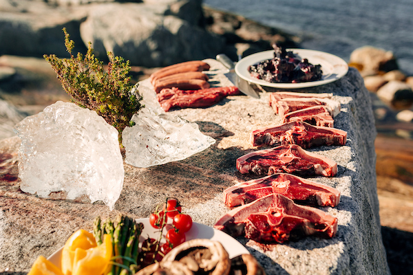 A selection of greenlandic meat being prepared on the rocks in Nuuk in Greenland.jpg