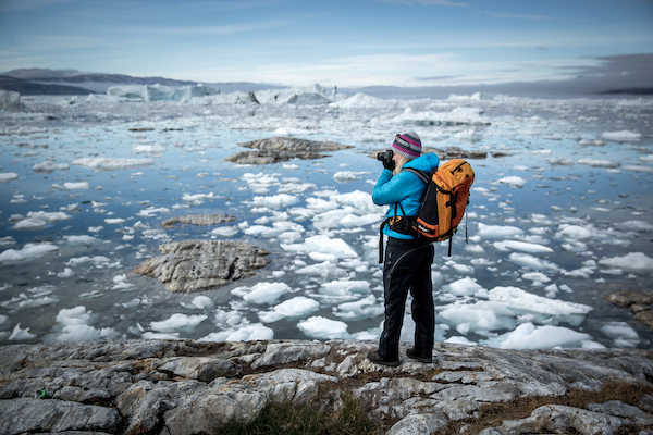 A photographer on an East Greenland photo tour to the Sermilik Icefjord.jpg