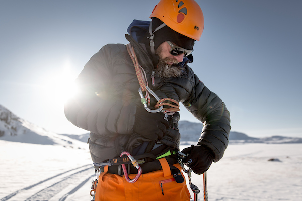 Bruno Compagnet gearing up for ice climbing with PGI Greenland in Ilulissat.jpg