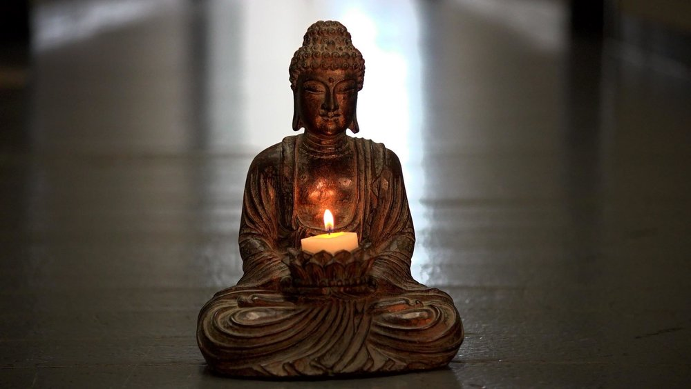 Buddha with candle.jpg