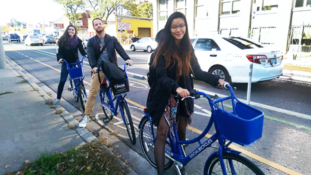 McMaster students riding SoBi bikes