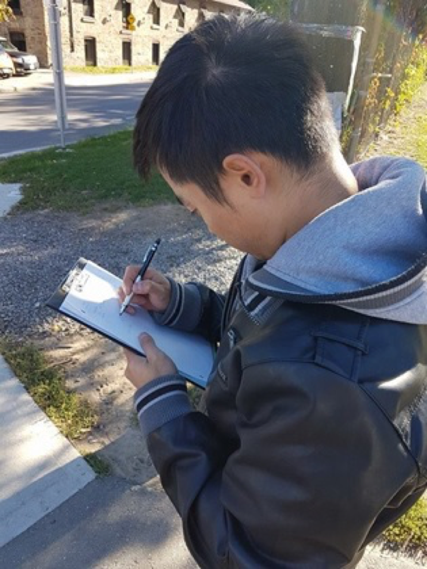 Student taking notes in the field