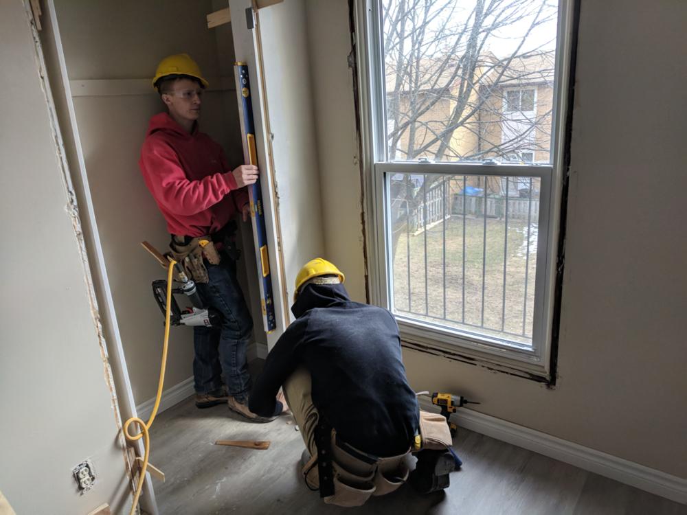 Mohawk students installing a doorframe.