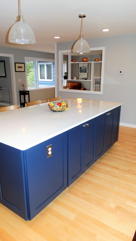 oversize-kitchen-island-blue-light-fixtures-cutout-wall-renovation-ohio.jpg