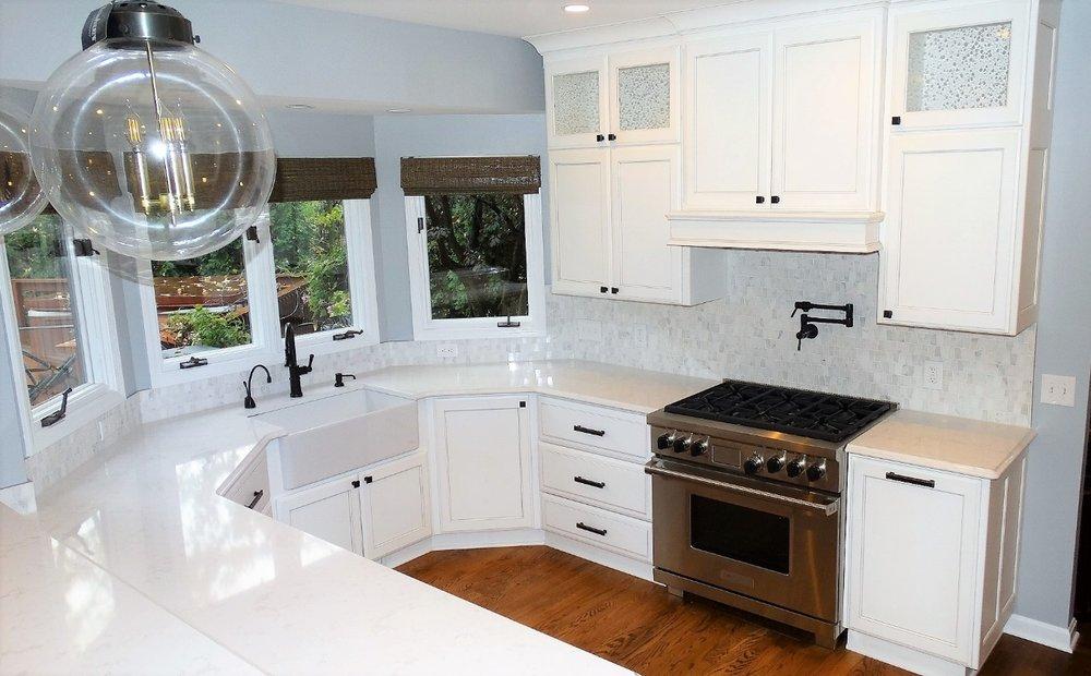white-cambria-quartz-kitchen-remodel-award-winning-wolf-appliances.jpg