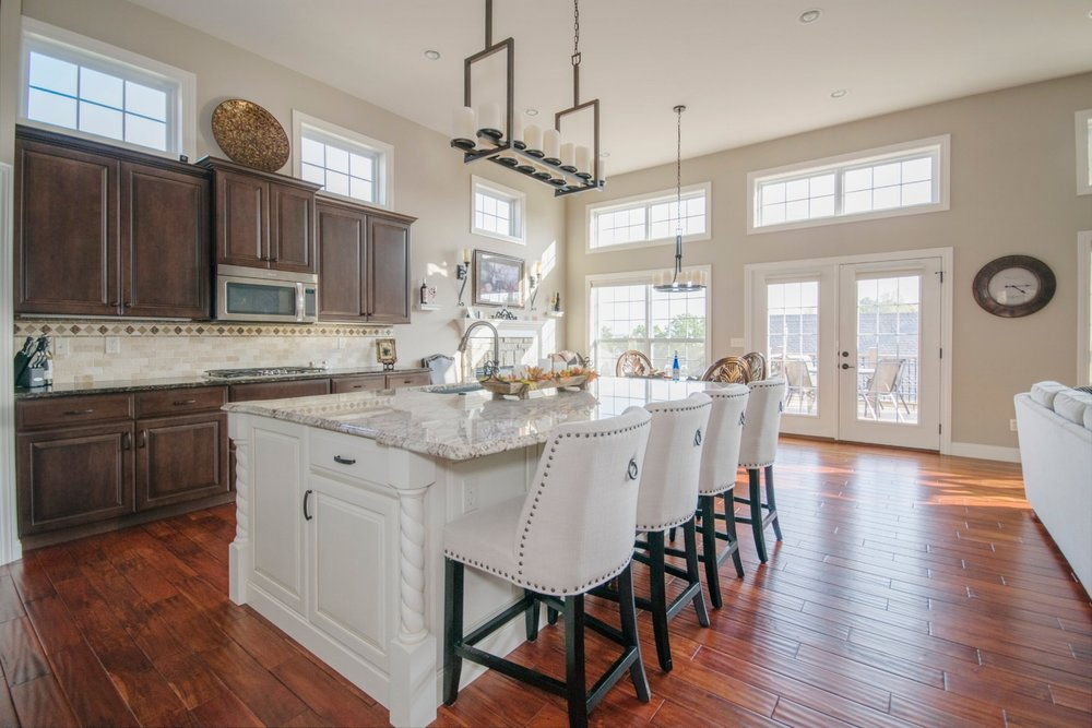 white-kitchen-island-wood-floors-windows-french-doors-cleveland-ohio-cabinet-contemporary-1082357.jpg